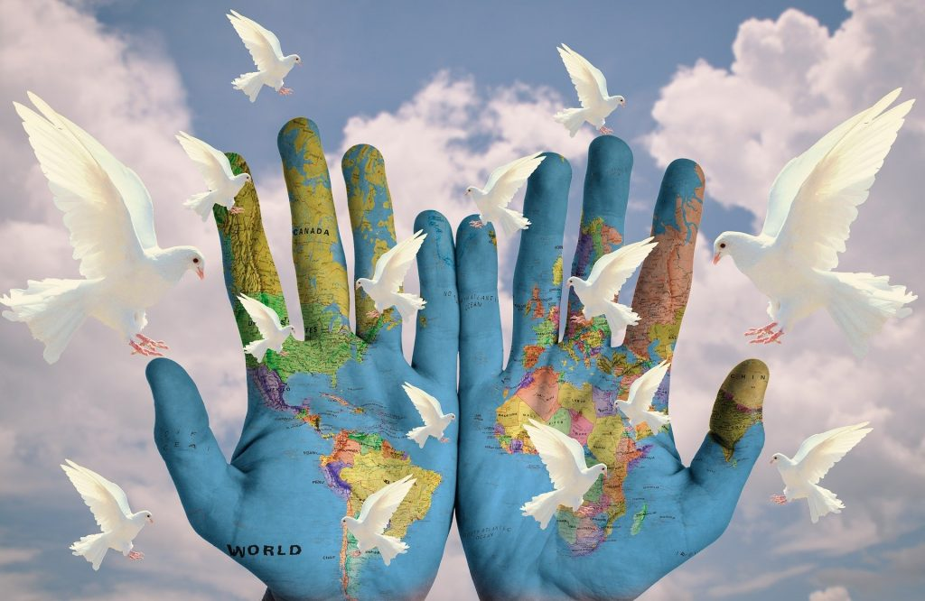 hands holding world map
